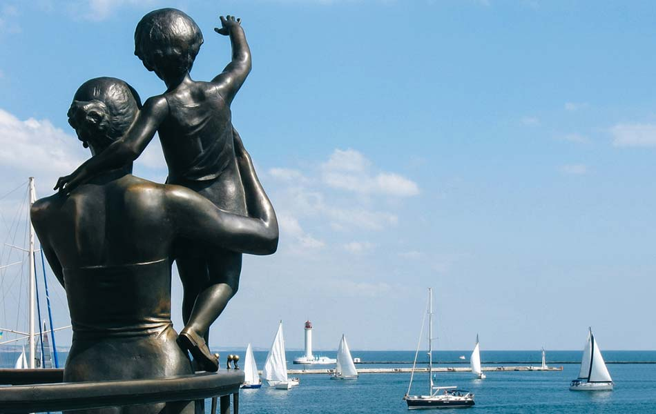 a status at the Odesa Sea Port of a mother holding a child